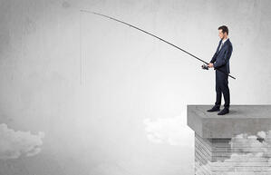 Businessman fishing nothing from the cloud with free copyspace-1