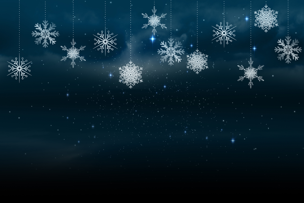 Digitally generated Snowflakes hanging against blue background